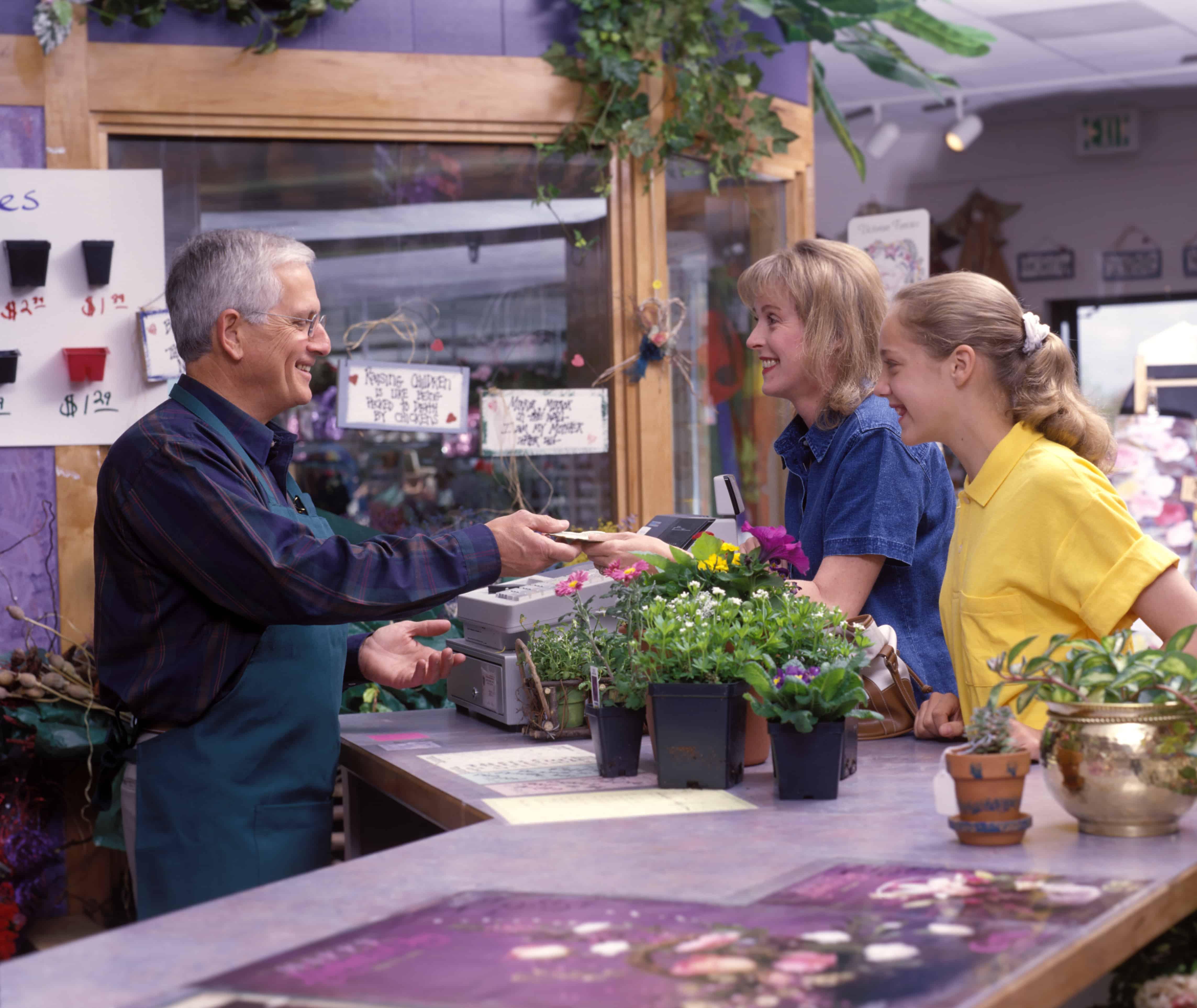 people in florist buying flowers